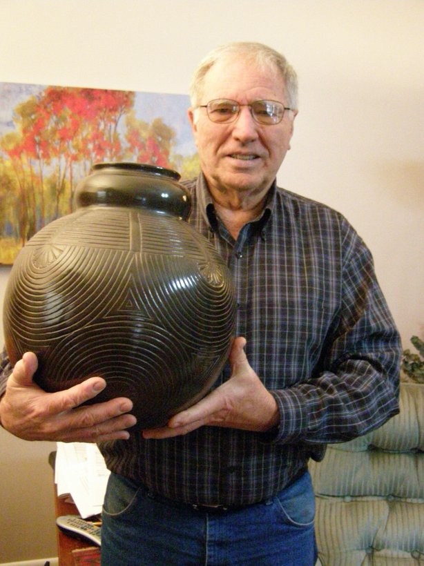 a man holding a very large pot